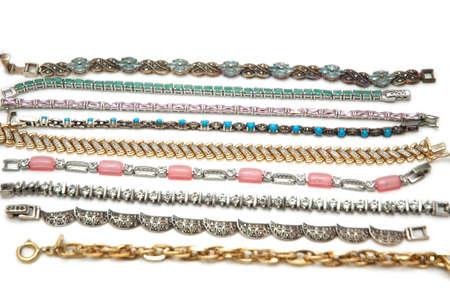 Various bracelets isolated on the white background photo