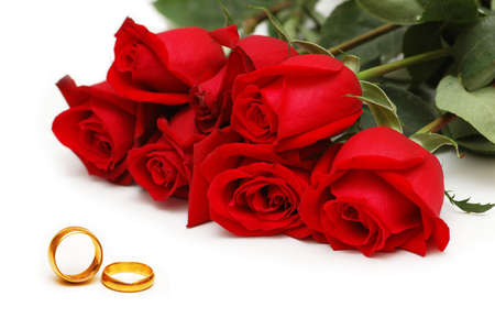Red roses and rings isolated on the white background Stock Photo - 2434915