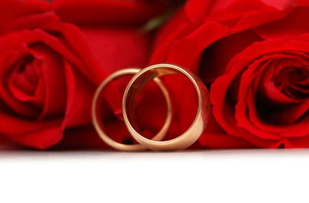 Red roses and rings isolated on the white background Stock Photo - 2434900