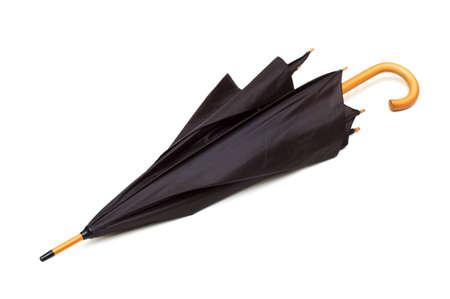 Black umbrella isolated on the white background photo