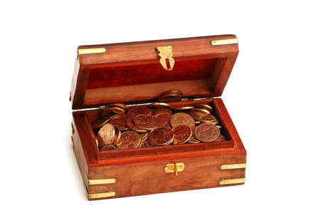 Wooden trunk full of golden coins isolated on white Stock Photo - 2528296