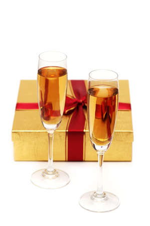 Glasses of champagne and gift on white photo