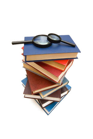 Magnifying glass over the stack of books Stock Photo - 2638050