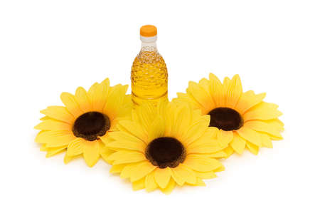 Three sunflowers and bottle of oil isolated on white photo