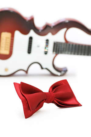 songwriter: Bow tie and guitar isolated on white