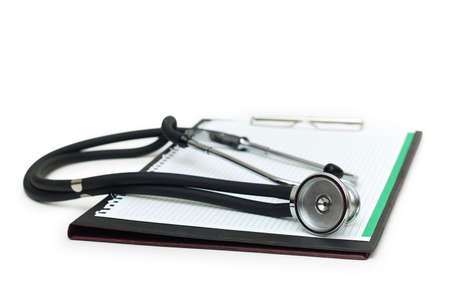 prescription pad: Stethoscope on the binder isolated on white Stock Photo
