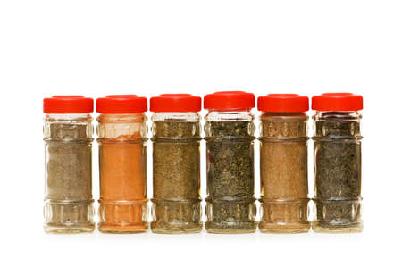 curry spices: Various spices in bottles isolated on white Stock Photo