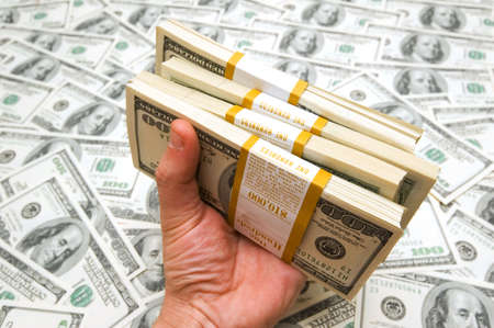 Hand holding american dollars against money background Stock Photo - 2779711