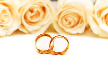 Roses and wedding rings isolated on the white Stock Photo - 2779576