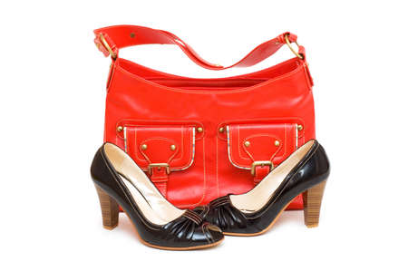 Red bag and black shoes isolated on white photo