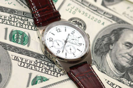 watch over: Hand watch over  the hundred dollar bank notes