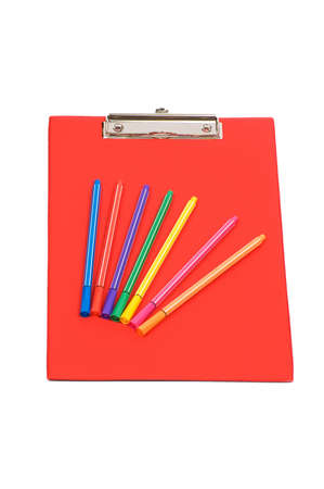 Red pad and colourful pencils isolated on white photo