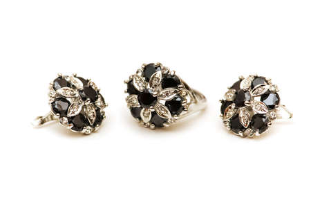Earrings with black and silver stones isolated on white photo