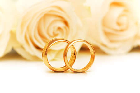 gold rings: Roses and wedding rings isolated on the white Stock Photo