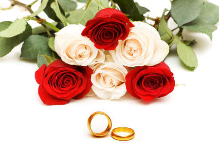 Roses and wedding rings isolated on the white Stock Photo - 3027728