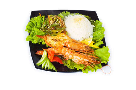 Grilled lobster, rice and vegetables isolated on white photo