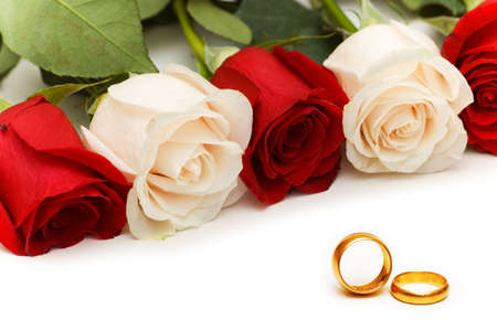 Roses and wedding rings isolated on the white Stock Photo - 3092255