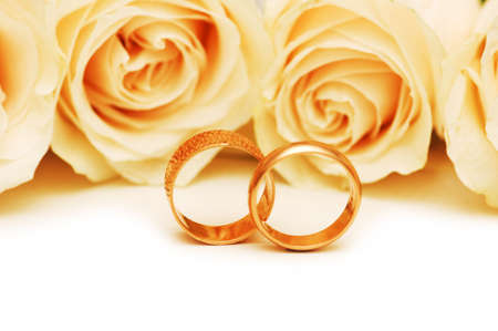 wedding ceremony: Roses and wedding rings isolated on the white Stock Photo