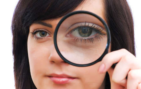 Girl's eye magnified through magnified glass on white Stock Photo - 3116378