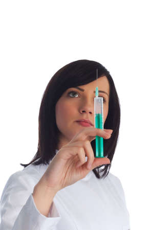 Woman checking syringe isolated on the white Stock Photo - 3116371