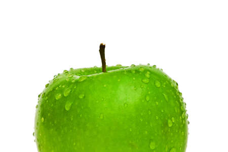 Green apple with dew isolated on white photo