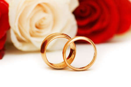 Golden rings and roses isolated on the white Stock Photo - 3218527