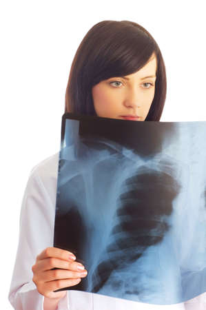 Female doctor looking at x-ray image on white Stock Photo - 3218647