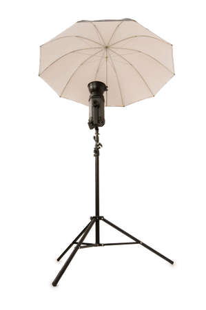 Studio strobe with umbrella isolated on the white Stock Photo - 3273835