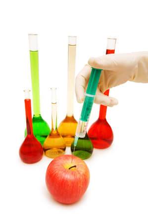 Hand injecting chemical into apple isolated on white Stock Photo - 3316488