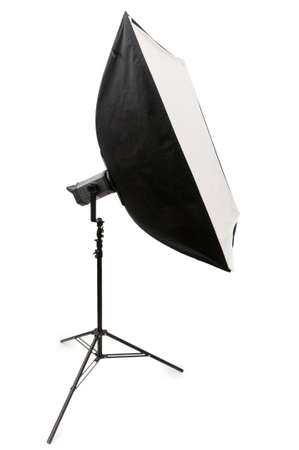Studio strobe with softbox isolated on the white photo
