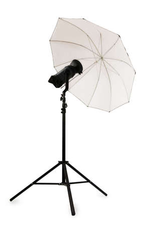 White studio umbrella isolated on the white photo