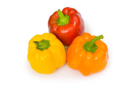 Three bell peppers isolated on the white photo