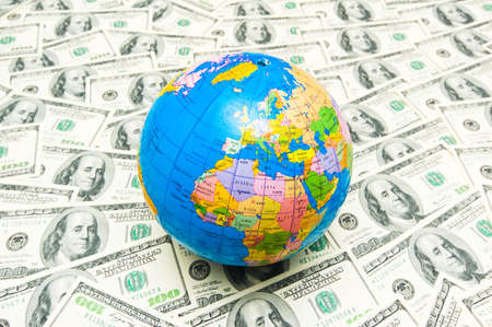 Globe over many american dollar bank notes Stock Photo - 3478463