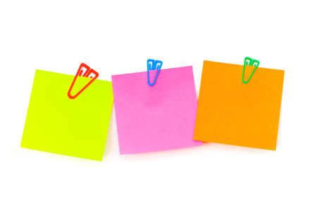 post it notes: Three notes with paper clips on the white board Stock Photo