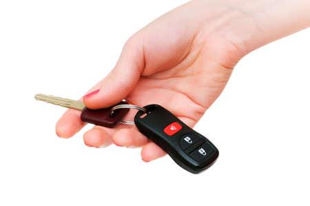 Hand holding keys isolated on the white photo