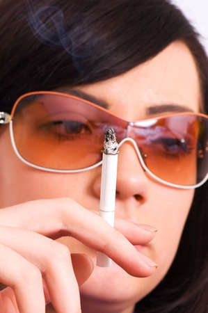 Health issues concept - Young girl smoking cigarette photo