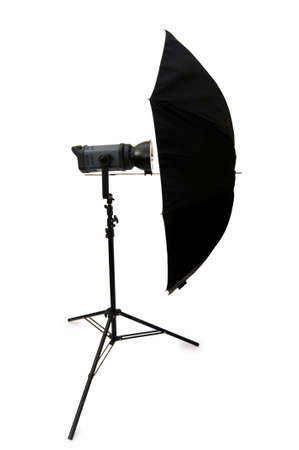 Black studio umbrella isolated on the white photo