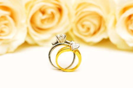 Diamond rings and roses isolated on the white photo