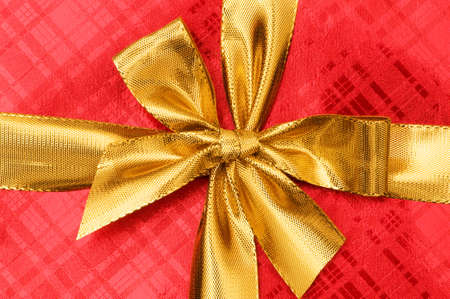 Close up of red gift box with golden ribbon photo