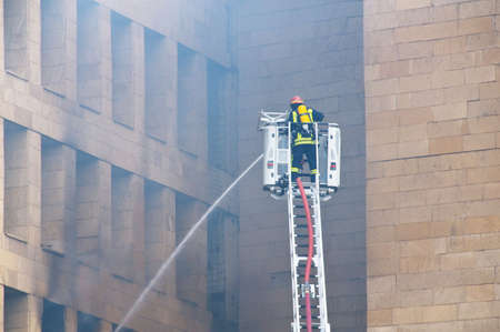 Firefighter at the fire in the city center photo