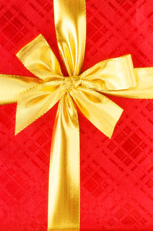 Close up of red gift box with gold bow photo