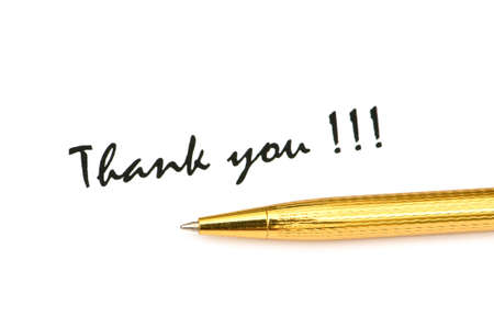 Thank you message and pen isolated on white photo