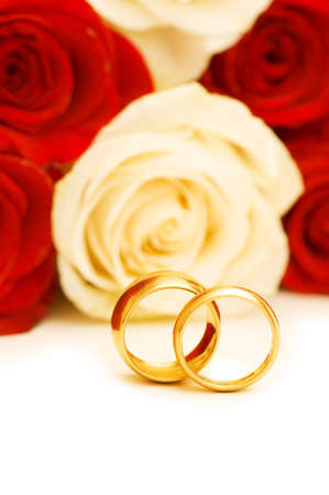 Roses and wedding rings isolated on the white Stock Photo - 3965431