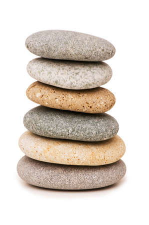Stack of pebbles isolated on the white background photo