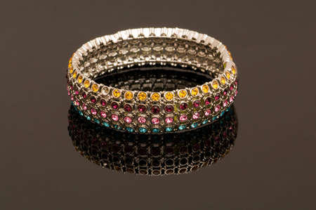 Hand bracelet on the highly reflective background photo