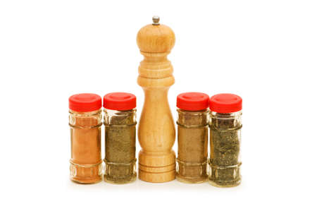 Peppermill and spices isolated on the white Stock Photo - 4082757