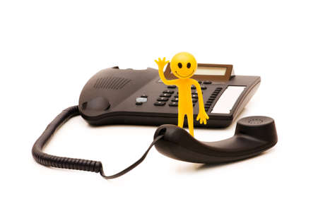 tabassum: Phone support concept  - smilie and telephone isolated on white