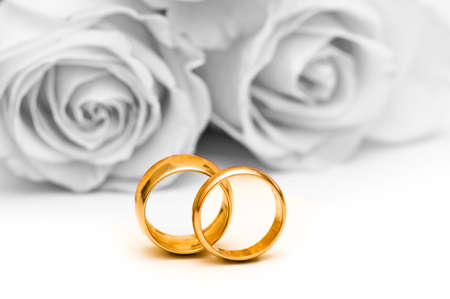 Roses and wedding ring isolated on the white Stock Photo