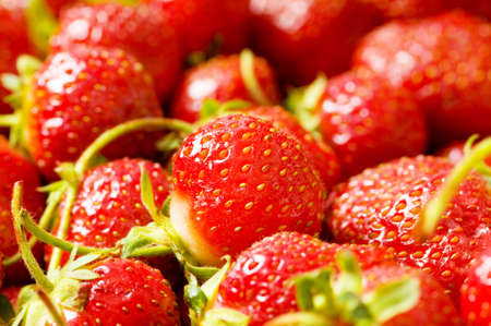 Fruit concept - red strawberries arranged as background photo