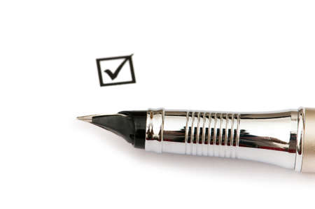 Pen and ticked tick box isolated on white Stock Photo - 4198175